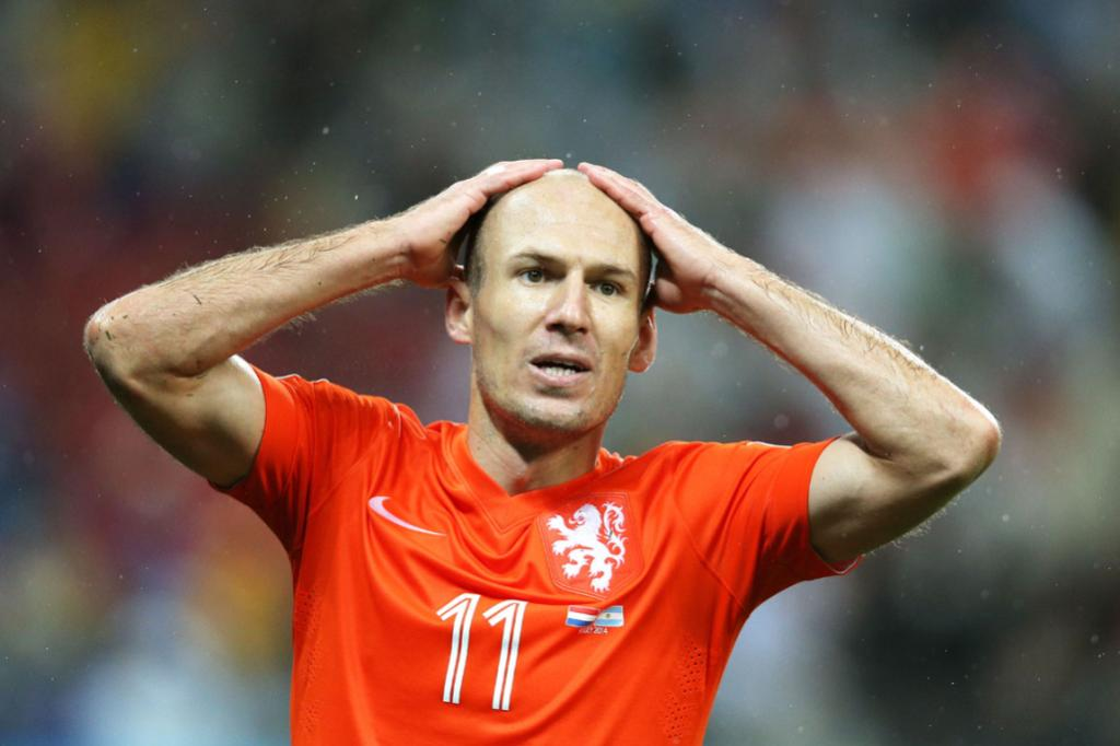 Arjen Robben reacts after missing his best chance on goal in the second half.