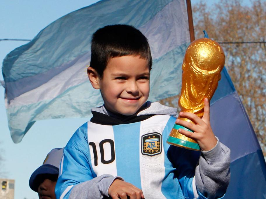 A boy in Buenos Aires watches on in hope Argentina can beat Netherlands in the World Cup semifinal.