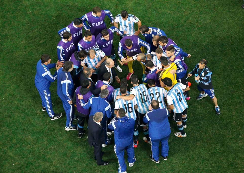 Argentina players huddle at the end of regulation time to talk tactics for extra time.