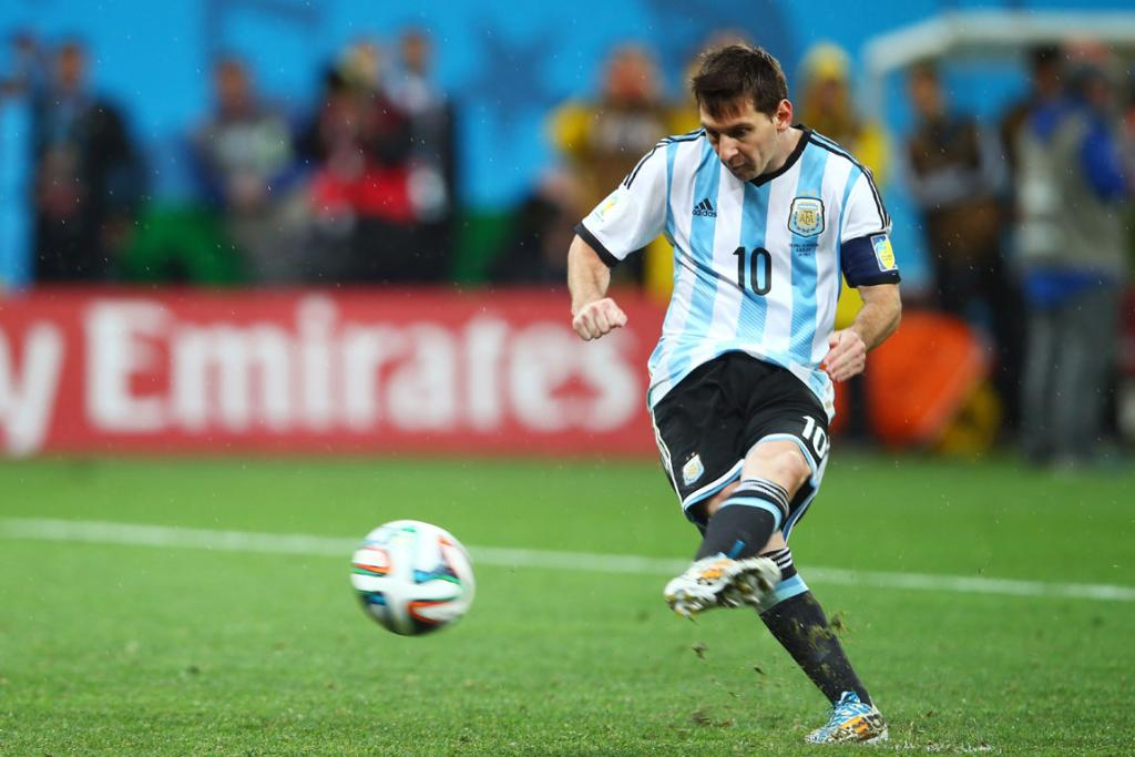 Lionel Messi of Argentina shoots and scores.
