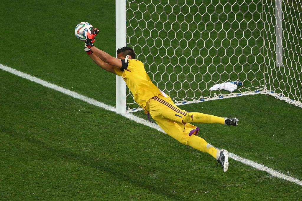 Sergio Romero of Argentina successfully saves a penalty shot from the Netherlands' Wesley Sneijder.