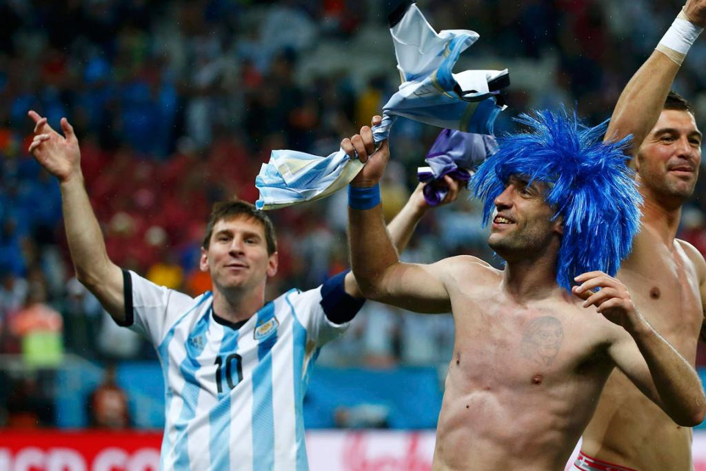 Lionel Messi and Pablo Zabaleta celebrate Argentina's semifinal win over Netherlands on the Corinthians pitch in Sao Paulo.