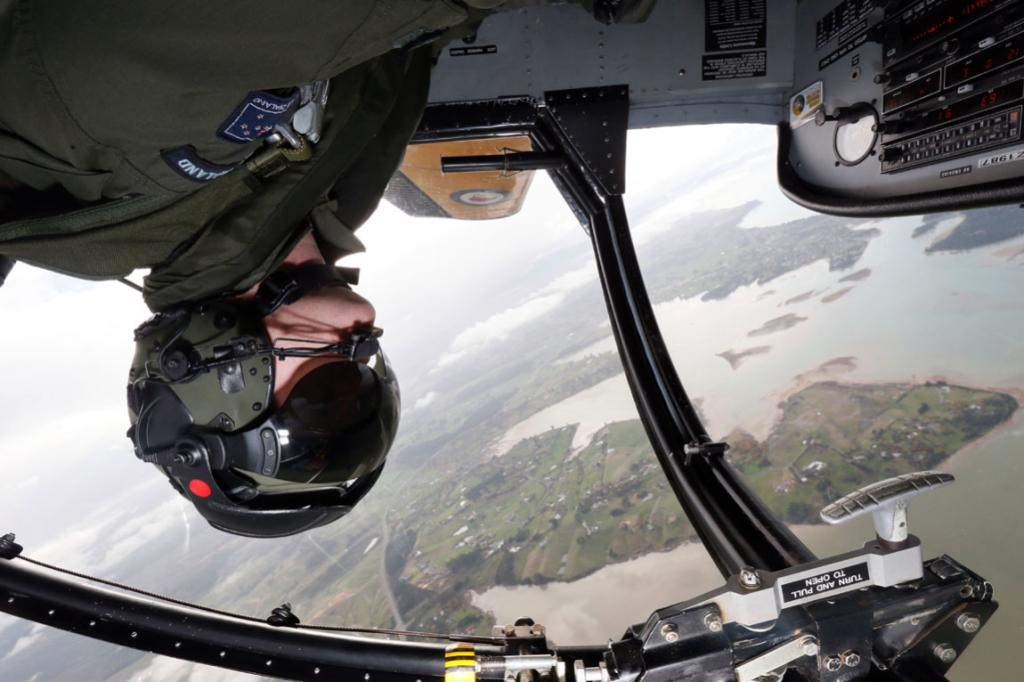 Royal New Zealand Air Force Flight Lieutenant Simon Isemonger inverted in a RNZAF Airtrainer aircraft over the Waimea Inlet.
