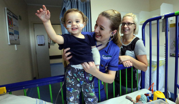 TICK OF APPROVAL: 22-month old Charlie Wells' heart is checked by nurse Jade Longmore under the watchful eye of his mother Marie Wells in the refurbished Waikato Hospital's Waikids ward.