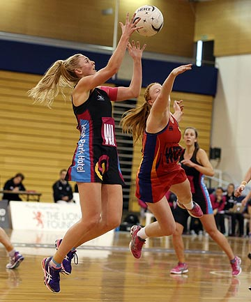 RISING TO THE CHALLENGE: South's Gina Crampton and Waikato's Samantha Sinclair in action during the national under-23 final in Dunedin.