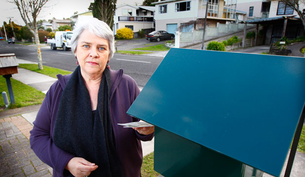 WHERE IS THE POSTMAN? Judi Billcliff is worried her mail-box will be made redundant.