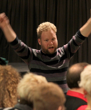 BIGN AND PUNCHY: Luke di Somma revs up the Christchurch Pops Choir in rehearsal.