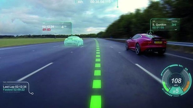 Jaguar has introduced 'ghost racing' with its new Virtual Windscreen concept.