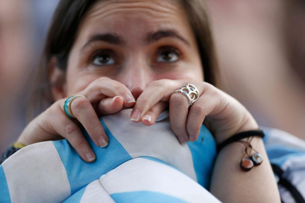 An Argentina fan looks on nervously at the Maracana stadium.
