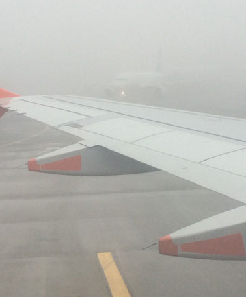 ANYBODY OUT THERE?: Fog still lingers at Auckland Airport.