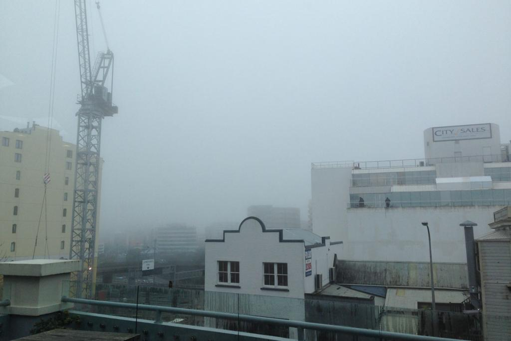 Thick fog is seen over the city.