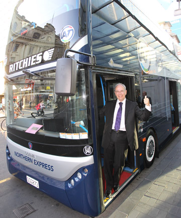 Auckland mayor Len Brown on a double-decker bus in 2013