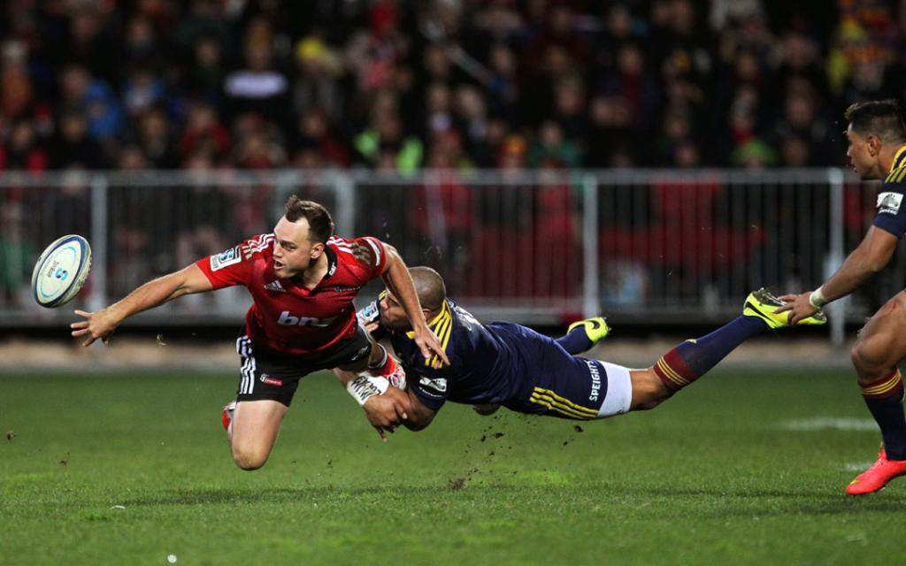 Israel Dagg shows his deft touch, unloading the ball while aerial in the tackle of Highlanders wing Patrick Osbourne.