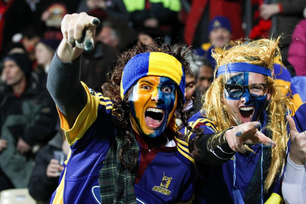 Highlanders fans cheer on their team in Christchurch in their round 19 Super Rugby game against the Crusaders.