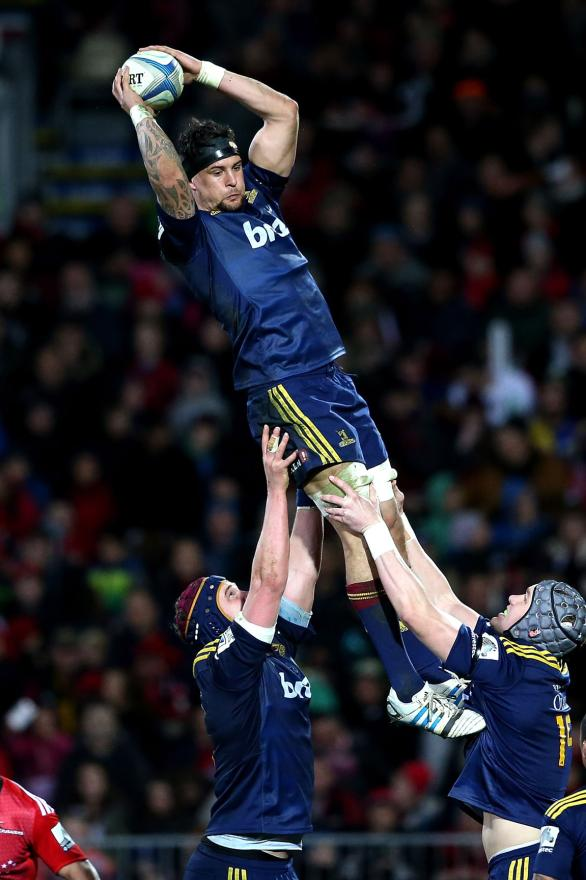 Highlanders lock Elliot Dixon reaches high to claim the ball in a lineout against the Crusaders.