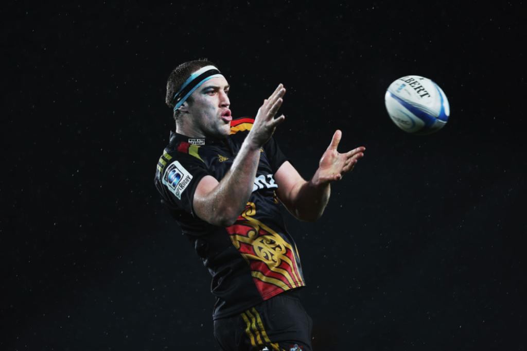 Chiefs lock Brodie Retallick reaches for the ball.