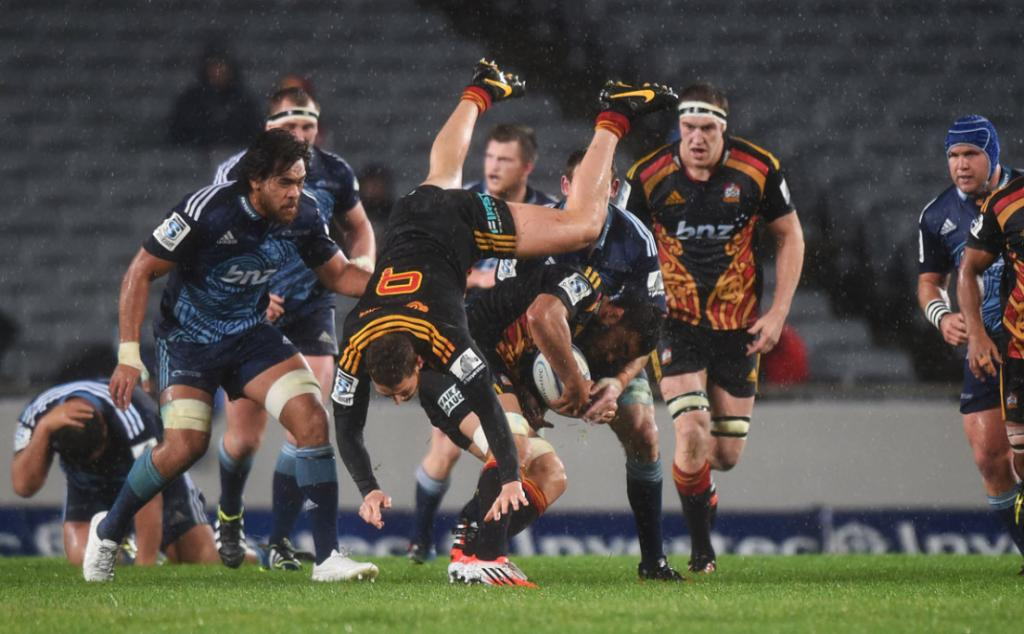 Halfback Tawera Kerr Barlow topples over in the Chiefs' round 19 Super Rugby game against the Blues.