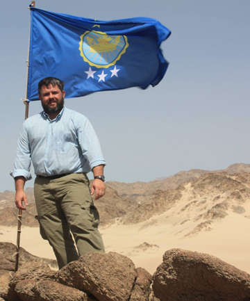 'A WISH GRANTED': Jeremiah Heaton wrote: 'I planted this flag in the Eastern African region of Bir Tawil to honour a promise I made to my daughter.'