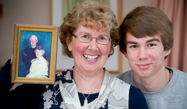 MEAT IN THE SANDWICH: Winnie Duggan with son David, 17, and a photo of her parents, Alex and Joyce Ross, both in their 80s. ntsG