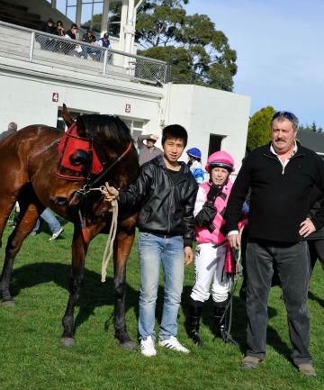 AIMING HIGH: Fly Me To Da Moon with strapper H Y Cheng,  jockey Casey Lunn and trainer Stephen Blair-Edie.