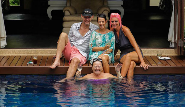 POOLED RESOURCES: Cristy Baker, centre top, relaxes at a friend's house in Phuket.
