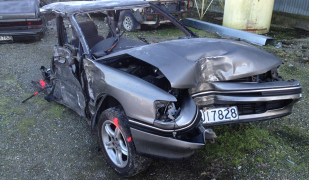 "FRONT HALF: The front half of the car that split in two after hitting a tree north of Mataura this morning. The ""very, very lucky"" driver sustained moderate injuries."