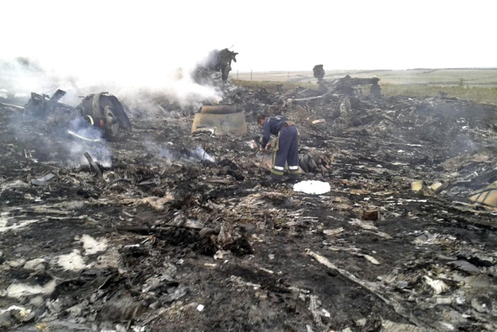 Emergencies Ministry members work at the site of a Malaysia Airlines plane crash near Grabovo, Ukraine.
