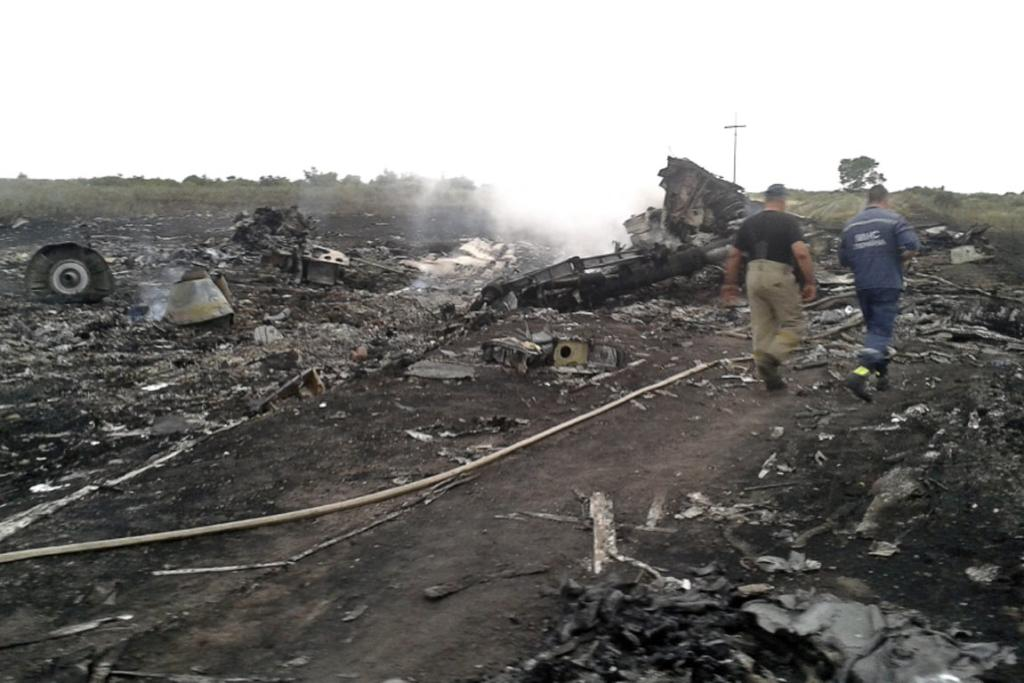 Wreckage from Malaysia Airlines flight 17 smoulders at the main crash site.