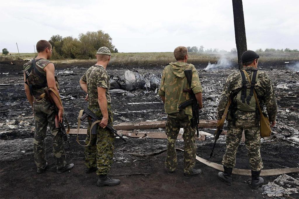 Armed pro-Russian separatists stand at the site of the Malaysia Airlines Boeing 777 plane crash near the settlement of Grabovo.