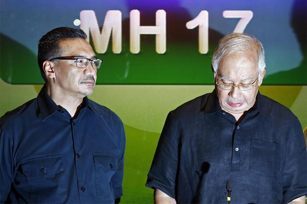 Talking to reporters, Malaysian Prime Minister Najib Razak (R) demands swift justice for those responsible for the crash of Malaysia Airlines flight MH17, as Defence Minister Hishammuddin Hussein looks on.