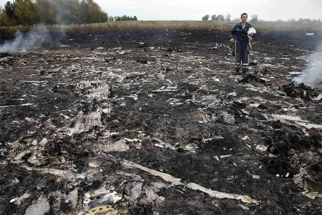 An Emergencies Ministry member walks through the site of the Malaysia Airlines plane crash.