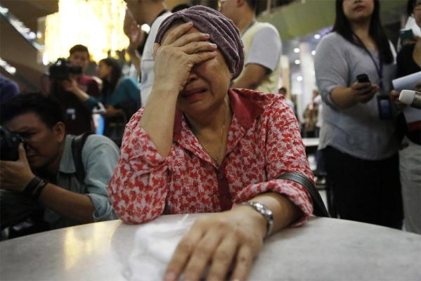 A woman who said she believed her sister was on Malaysia Airlines flight MH17, cries as she waits for more information.