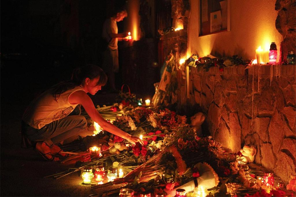 People light candles at the Dutch embassy for victims of Malaysia Airlines MH17.