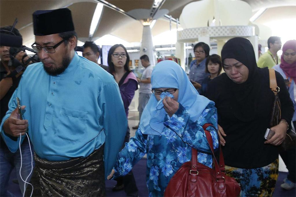 Relatives of passengers onboard the downed Malaysia Airlines flight MH17 arrive at Kuala Lumpur International Airport.