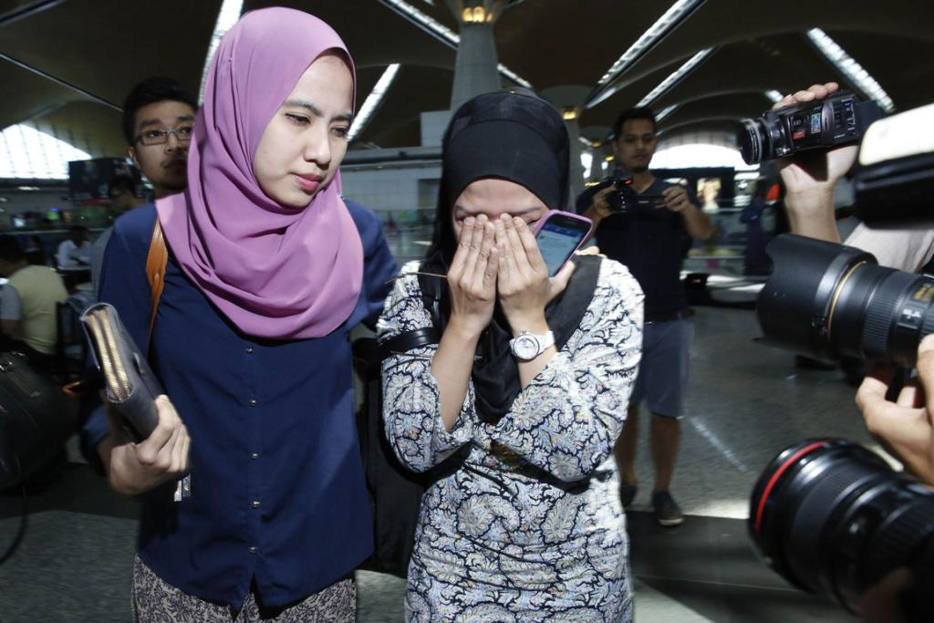 Relatives of passengers on board Malaysia Airlines flight MH17 arrive at Kuala Lumpur International Airport.