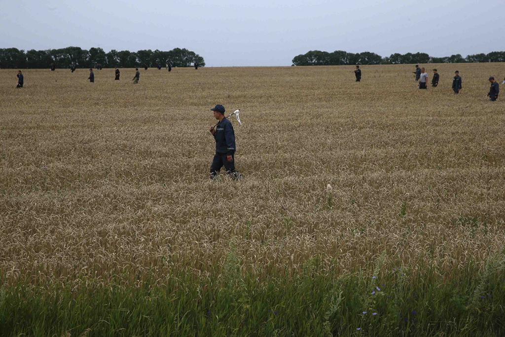 Members of the Ukrainian Emergency Ministry search for bodies near the site of Thursday's Malaysia Airlines Boeing 777 plane crash.