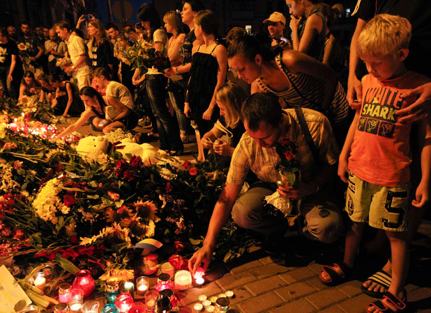 A SEA OF FLOWERS: People place candles and flowers at the Dutch embassy for victims of Malaysia Airlines MH17, which crashed in eastern Ukraine.