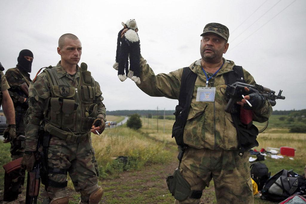 A pro-Russian separatist holds a stuffed toy found at the crash site of Malaysia Airlines flight MH17.