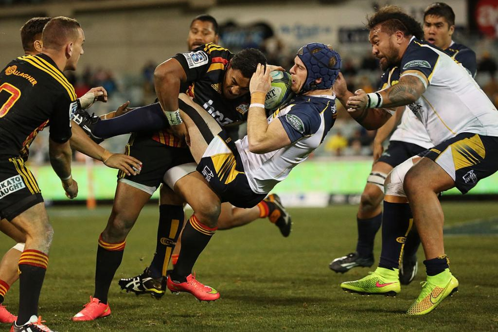 Brumbies second-five Pat McCabe is lifted off his feet in a Chiefs tackle.