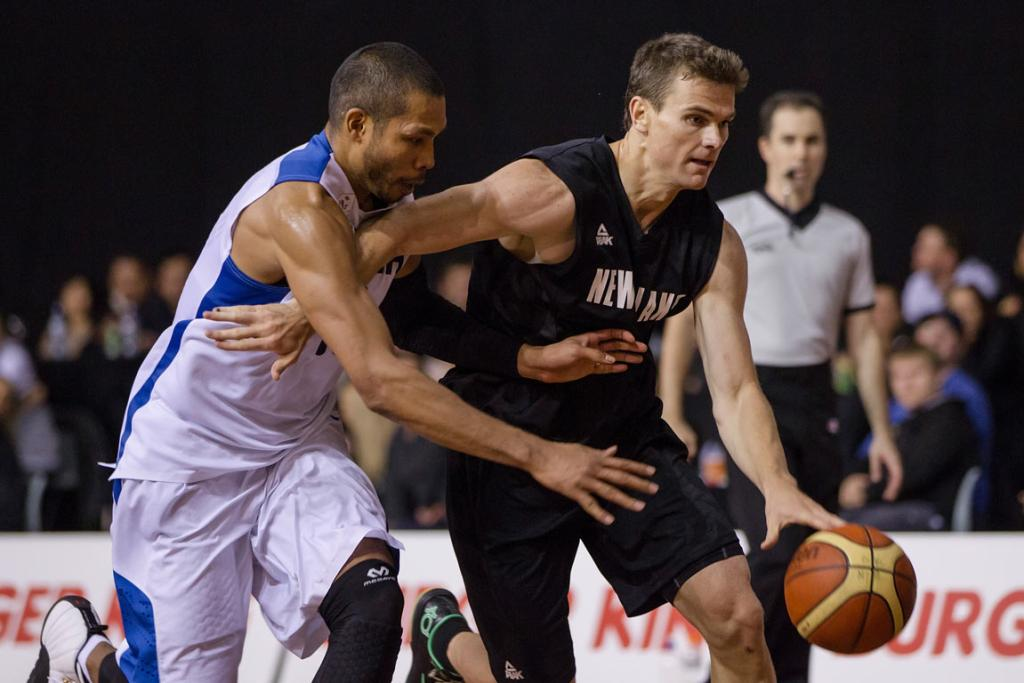 Kirk Penney holds off South Korea's Tae Jong Moon as he drives to the basket.
