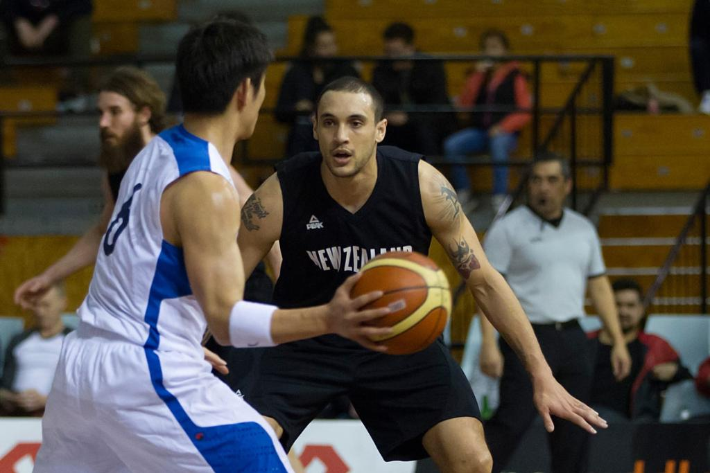 Tall Blacks point guard Lindsay Tait defends South Korea's Dong Geun Yang.