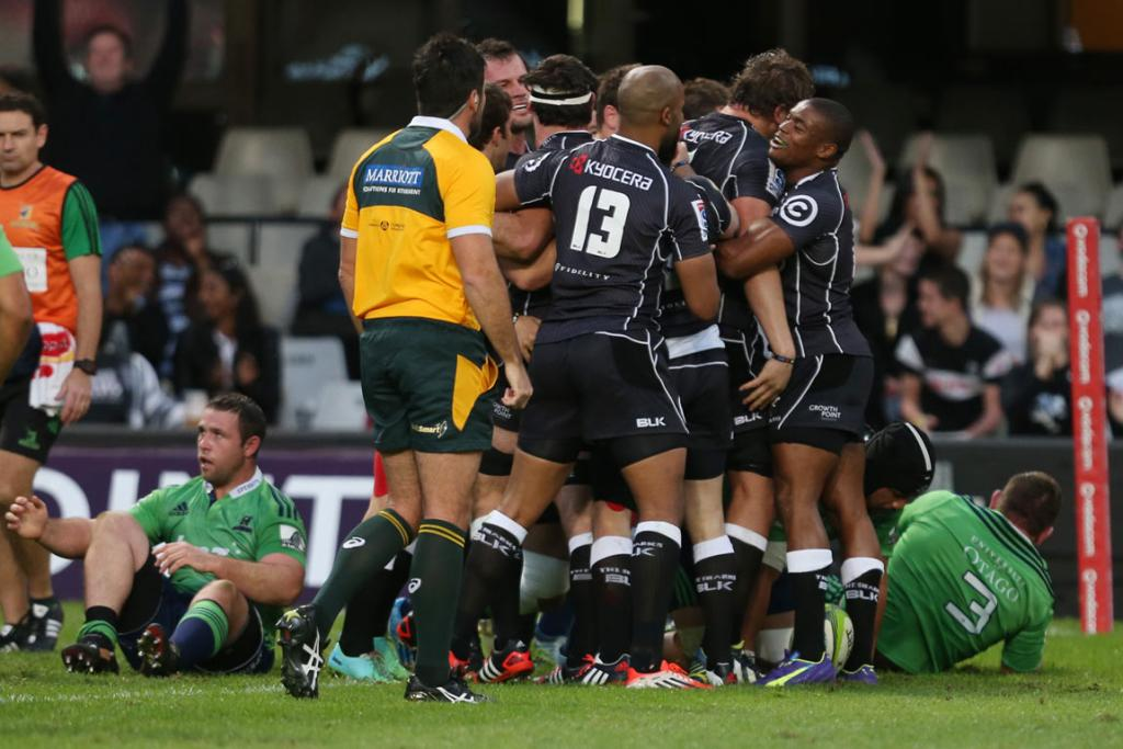 The Sharks celebrate Marcell Coetzee's second-half try against the Highlanders.