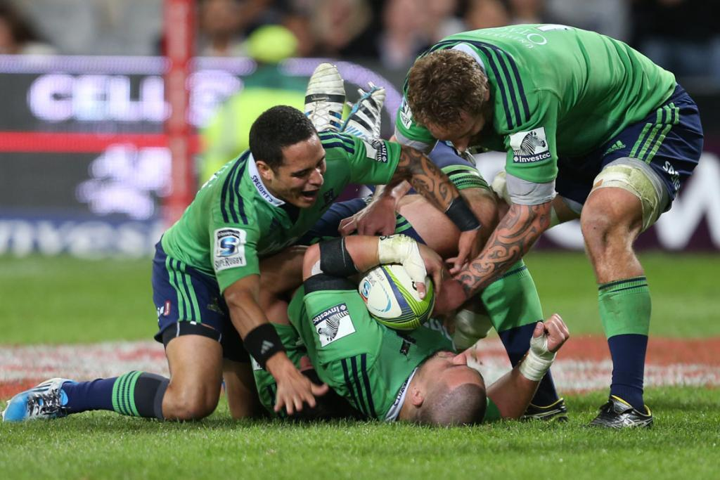 The Highlanders pile on prop Kane Hames after his try after the siren in the first half.