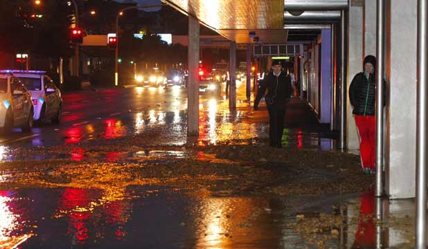 SINKING FEELING: People walk past the sink hole on Jervois Quay early this morning.