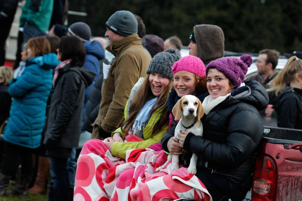 Watching the game at Strathconan Park in Fairlie with their beagle dog Lochie are from left, Amelia Murray, Emily Gualter and Sallie Mackay.