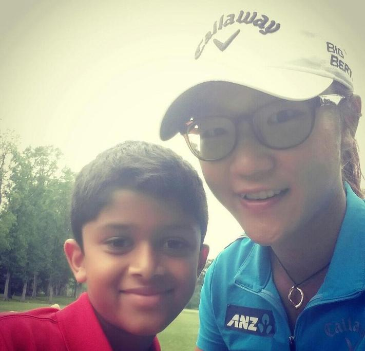 Lydia Ko takes a selfie with a young fan during a pro-am event.