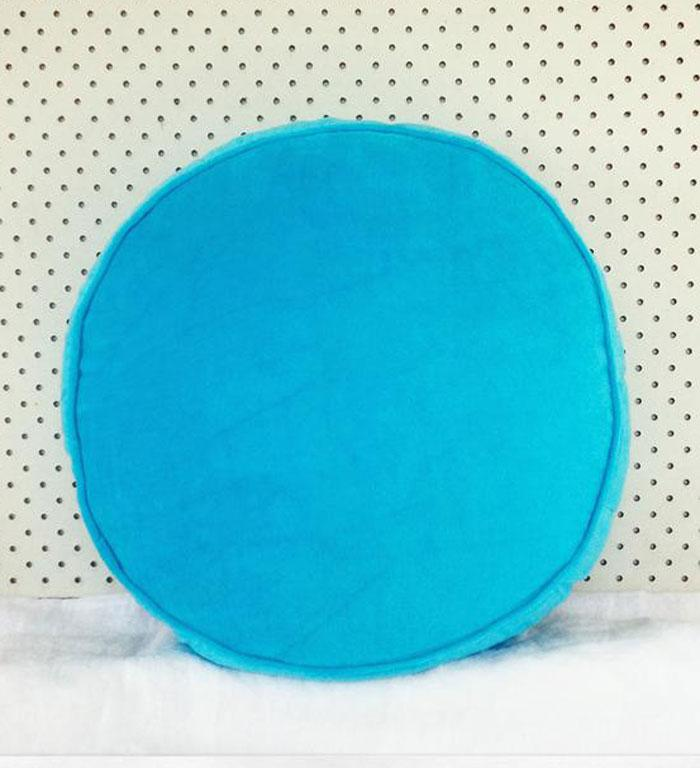 """TURQUOISE ROUND VELVET CUSHION, $79: Snuggle up on the couch with this soft velvet cushion as your new best friend. In a beautiful turquoise hue, it's 40cm in diameter and will be sure to brighten up your day. Available from <a target=""""_blank"""" href=""""http://www.jamiekay.co.nz/home/Turquoise-Round-Velvet-Cushion """"> Jamie Kay.</a>"""