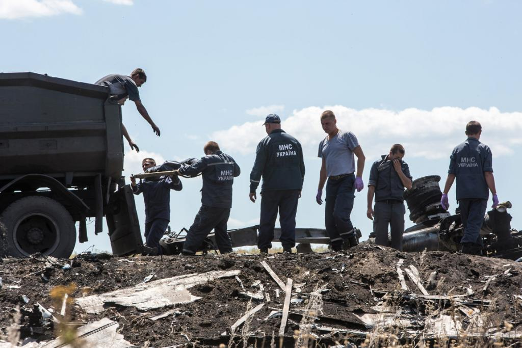 Bodies are loaded into a truck at the crash site by Ukrainian Emergencies Ministry staff.