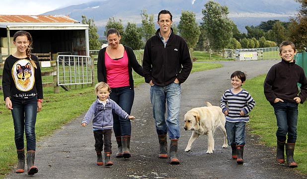 Danielle, Hunter, Margery, Aaron, Karlin and Joseph Snowden and dog, Gumboot, are enjoying life on the Tariki dairy farm the family purchased last year.