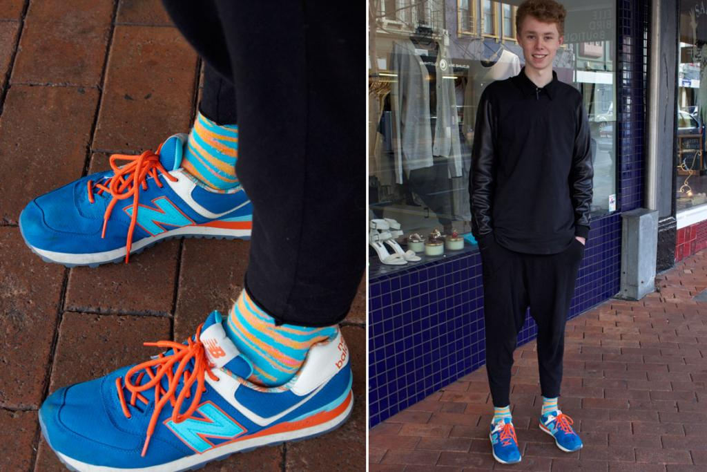Patrick, photographed on George St, Dunedin wear a Commoners jumper, Maaike pants, Happy Socks and a pair of eye-catching New Balance sneakers.